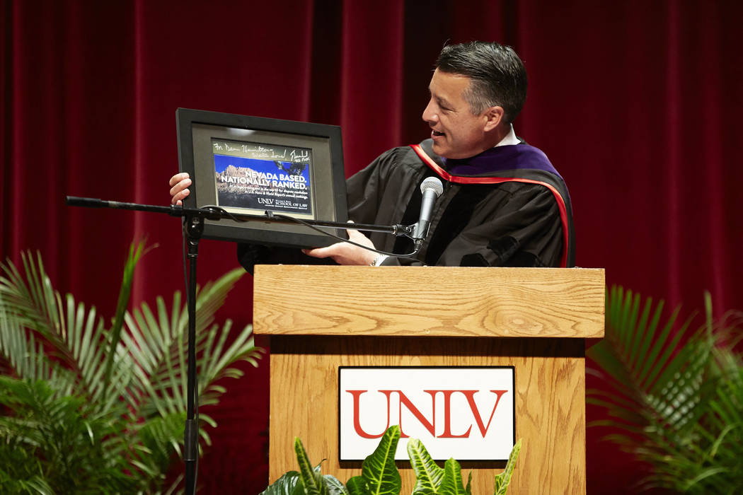 Governor Brian Sandoval presenting an award to Dean Hamilton at the Boyd School of Law commencement ceremony. Law School Commencement. (Josh Hawkins/UNLV Creative Services)