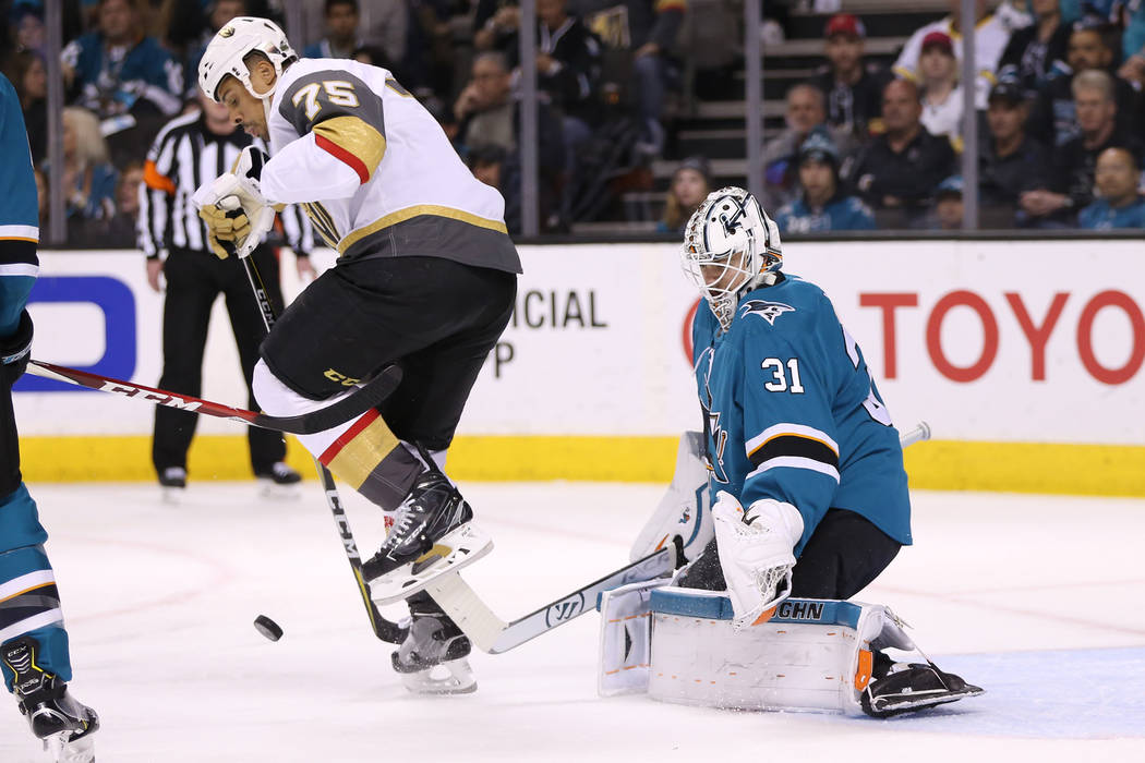 Vegas Golden Knights right wing Ryan Reaves (75) leaps out of the way as San Jose Sharks goaltender Martin Jones (31) defends his goal during the first period in Game 6 of an NHL hockey secon ...