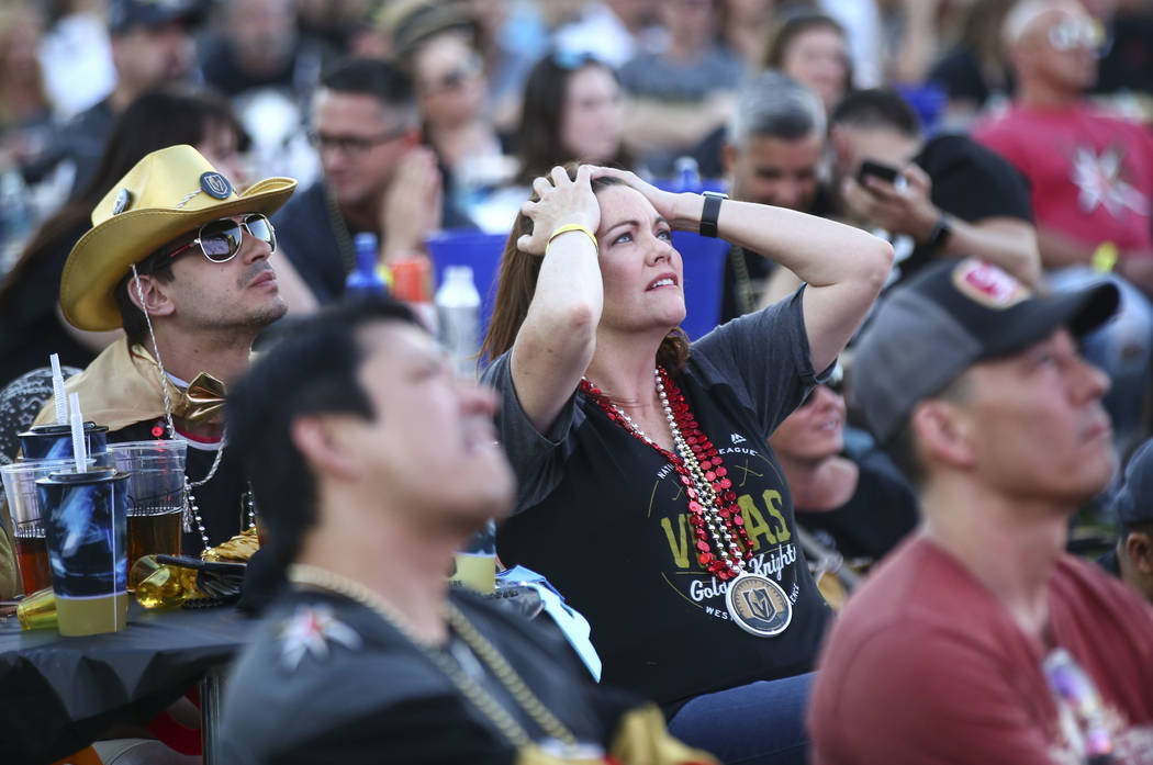 Allison Mayo, center, and her husband Vincent, left, react as the Golden Knights trail the Winnipeg Jets in the third period during a watch party for Game 1 of the team's Western Conference Final ...