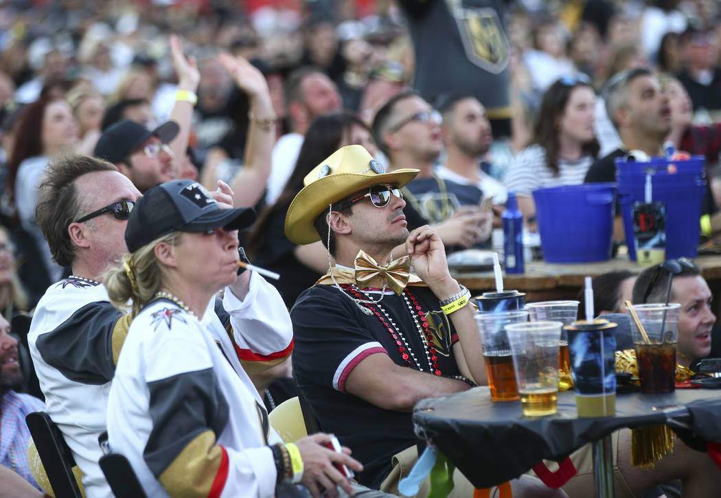 Vincent Mayo, center, reacts as the Golden Knights trail the Winnipeg Jets in the third period during a watch party for Game 1 of the team's Western Conference Final at the Downtown Las Vegas Even ...