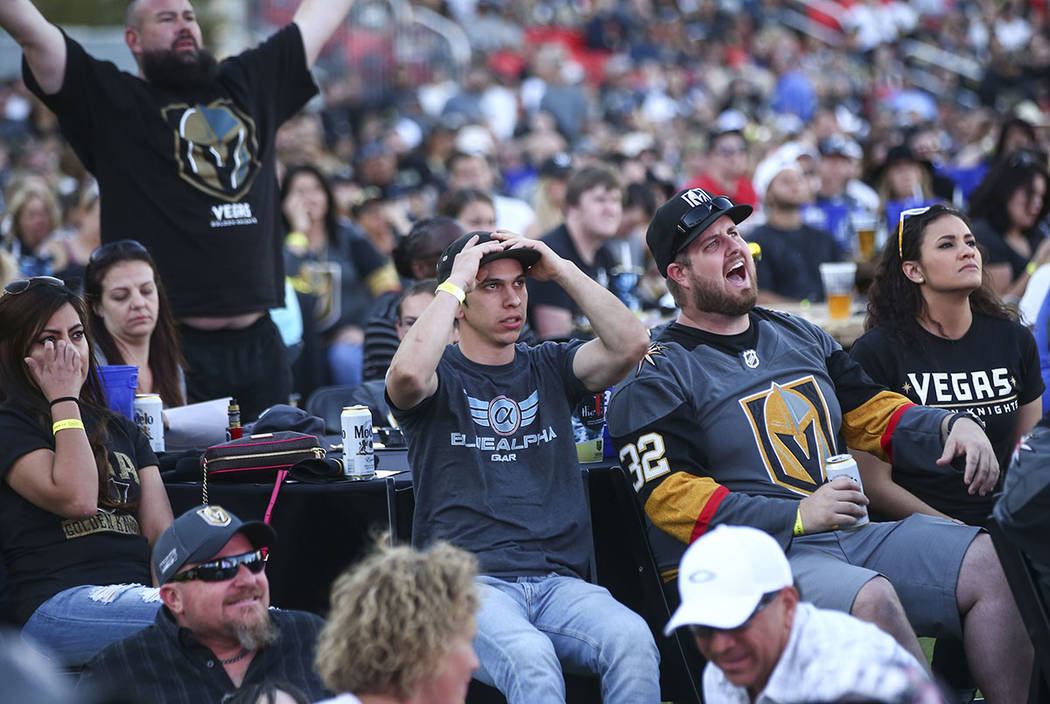 Taylor Jones, center, reacts as the Golden Knights trail the Winnipeg Jets in the third period during a watch party for Game 1 of the team's Western Conference Final at the Downtown Las Vegas Even ...