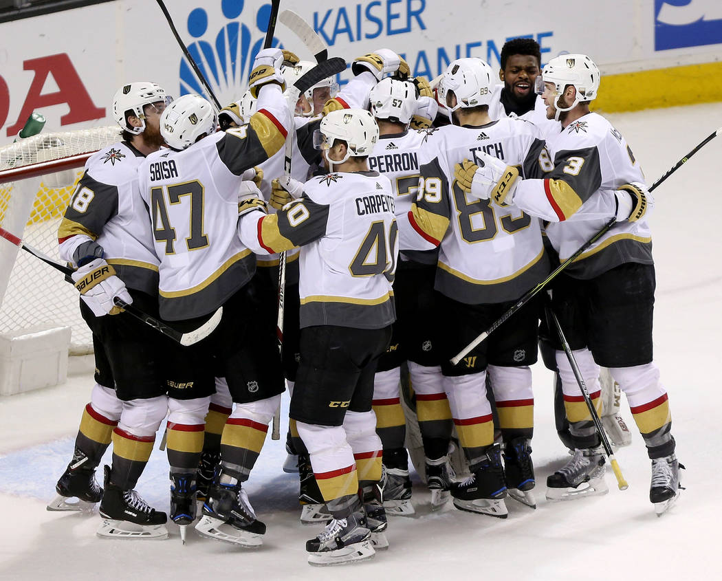 Vegas Golden Knights celebrate their 3-0 win against San Jose Sharks in Game 6 of an NHL hockey second-round playoff series at the SAP Center in San Jose, Calif., Sunday, May 6, 2018. Vegas Golden ...