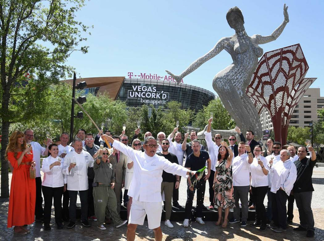Surrounded by fellow star chefs, Masaharu Morimoto ceremoniously sabers a bottle of Prosecco at The Park on Thursday, May 11, 2018, officially launching the 12th annual Uncor'd by Bon Apetit. (Las ...