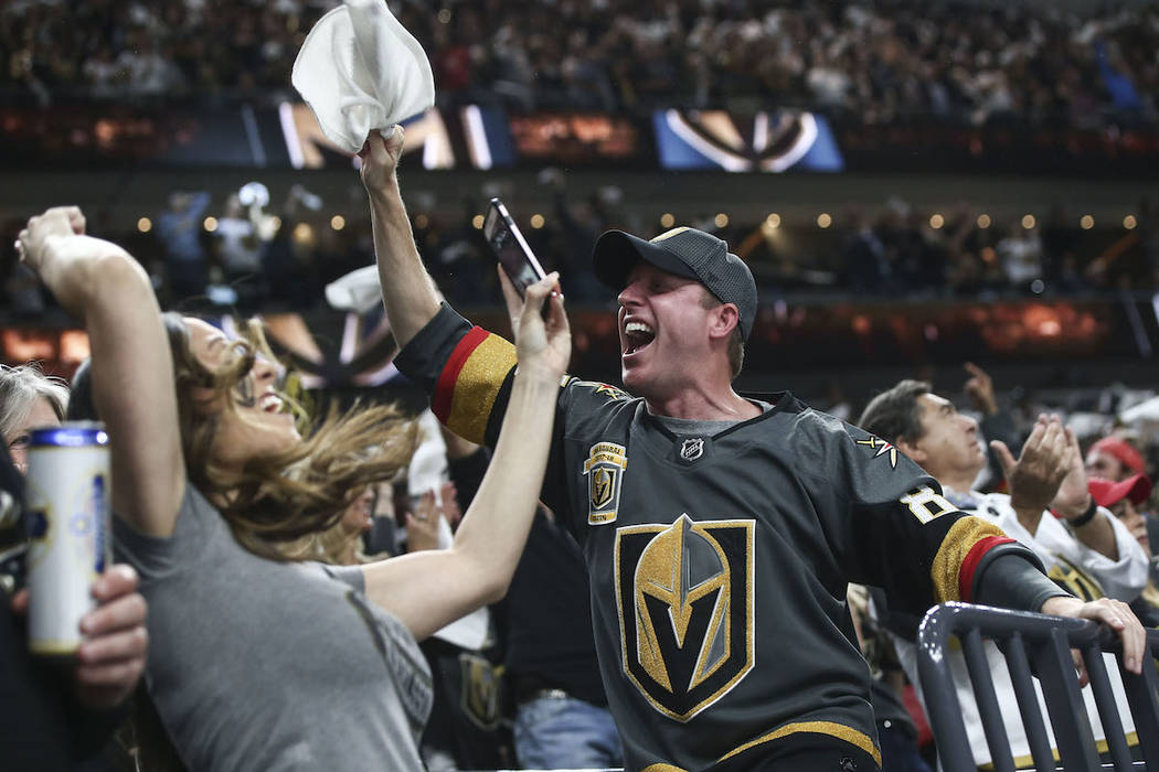 Golden Knights fans celebrate a goal by Golden Knights left wing James Neal, not pictured, against the San Jose Sharks during the first period of Game 5 of an NHL hockey second-round playoff serie ...