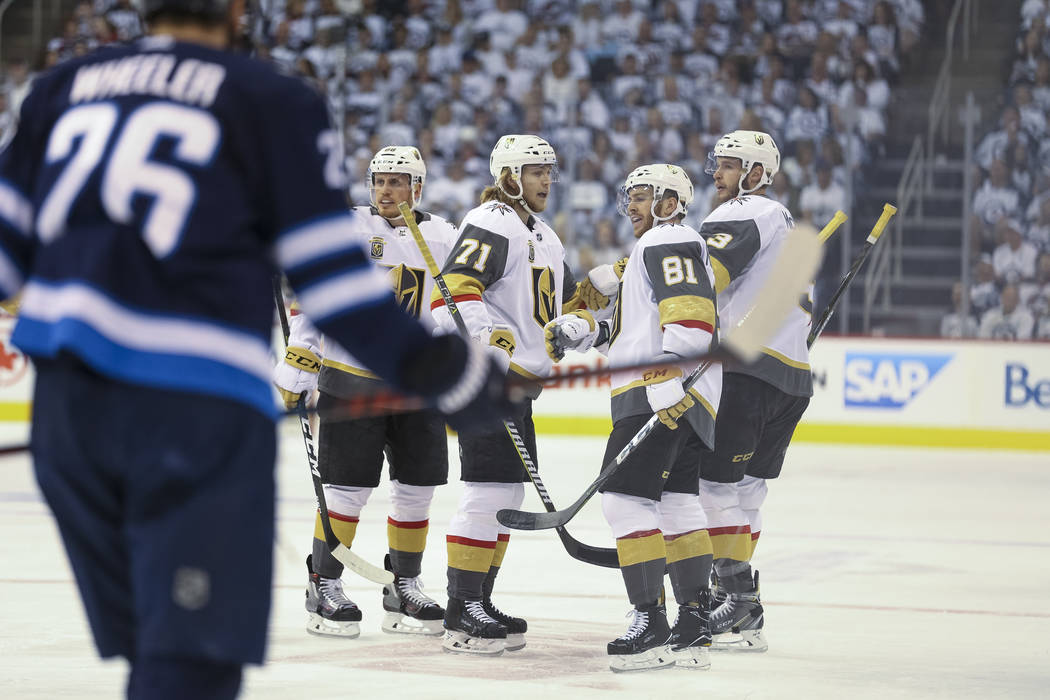 Vegas Golden Knights celebrate a first period goal by defenseman Brayden McNabb against the Winnipeg Jets in Game 1 of an NHL hockey third-round playoff series at the Bell MTS Place in Winnipeg, C ...