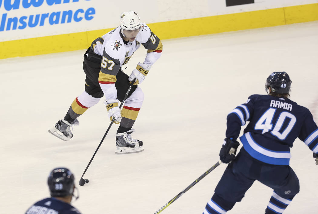 Vegas Golden Knights left wing David Perron (57) looks for a pass as Winnipeg Jets right wing Joel Armia (40) closes in during the second period in Game 1 of an NHL hockey third-round playoff seri ...