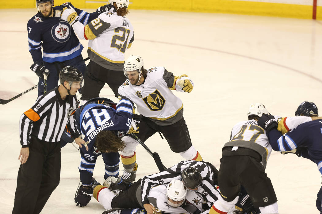 Vegas Golden Knights and Winnipeg Jets players fight during the second period in Game 1 of an NHL hockey third-round playoff series at the Bell MTS Place in Winnipeg, Canada, on Saturday, May 12, ...