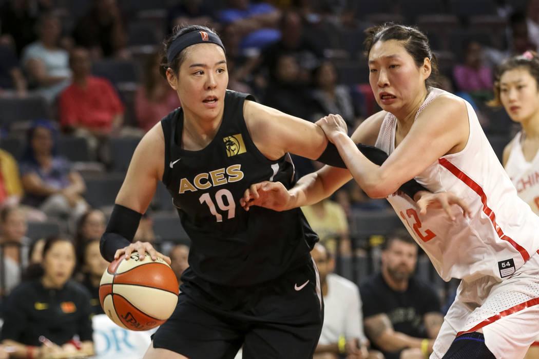 Las Vegas Aces center Ji-Su Park (19) drives the ball against China's Jiacen Liu (12) during a preseason basketball game at Mandalay Bay Events Center in Las Vegas on Sunday, May 6, 2018. Richard ...