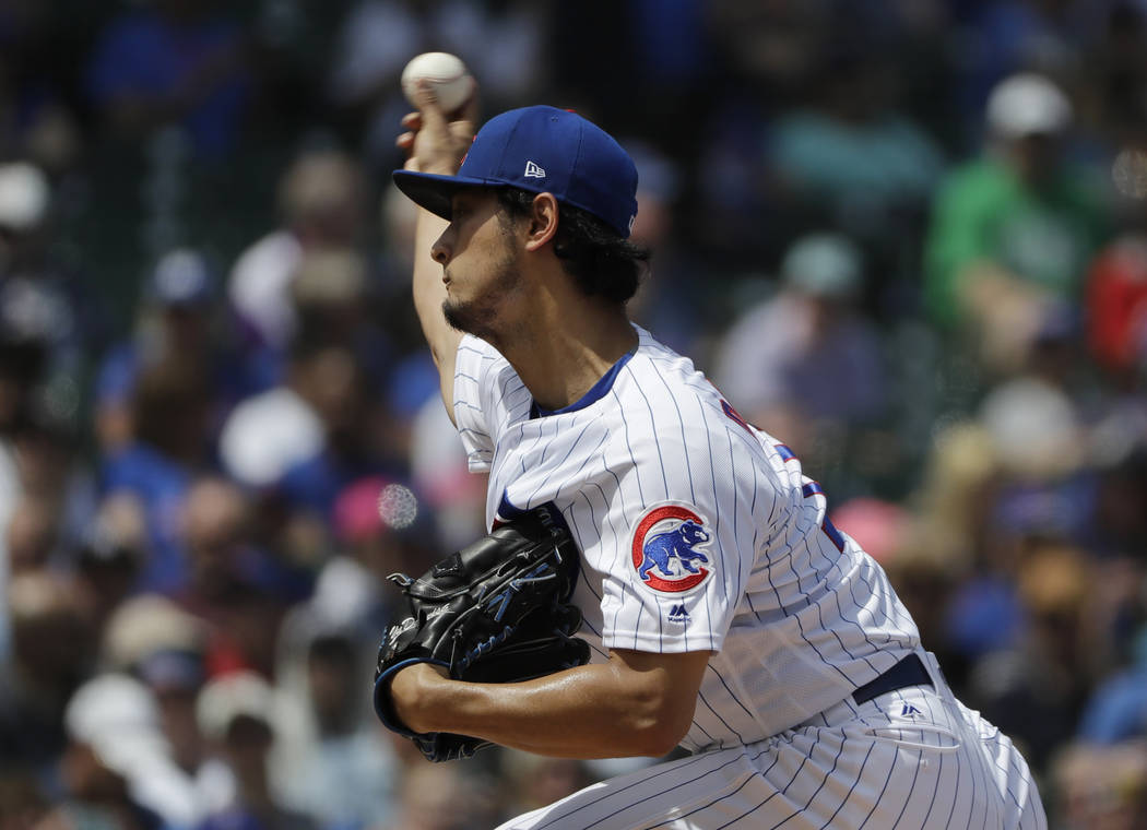 Chicago Cubs starting pitcher Yu Darvish, of Japan, throws against the Colorado Rockies during the first inning of a baseball game Wednesday, May 2, 2018, in Chicago. (AP Photo/Nam Y. Huh)