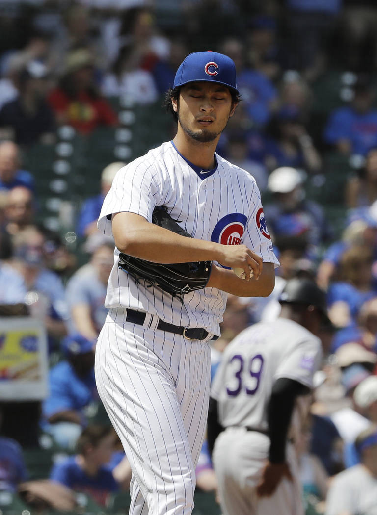 Chicago Cubs starting pitcher Yu Darvish, of Japan, reacts after Colorado Rockies' Nolan Arenado hit a two-run home run during the first inning of a baseball game Wednesday, May 2, 2018, in Chicag ...