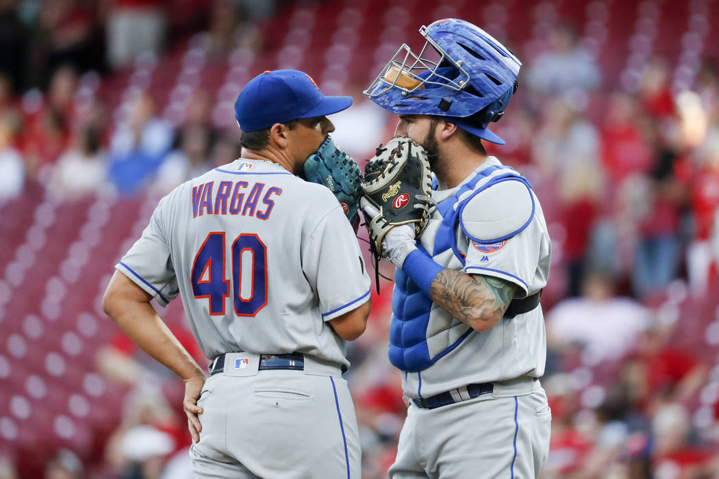 New York Mets starting pitcher Jason Vargas (40) meets with catcher Tomas Nido, right, in the first inning of a baseball game against the Cincinnati Reds, Tuesday, May 8, 2018, in Cincinnati. (AP ...