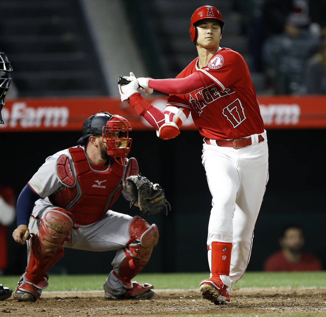 Los Angeles Angels designated hitter Shohei Ohtani (17), of Japan, strikes out with Minnesota Twins catcher Bobby Wilson watching during the seventh inning of a baseball game in Anaheim, Calif., F ...