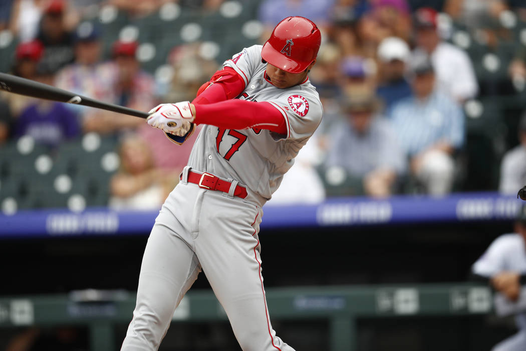 Los Angeles Angels pinch-hitter Shohei Ohtani (17) in the eighth inning of an interleague baseball game Wednesday, May 9, 2018, in Denver. The Angels won 8-0. (AP Photo/David Zalubowski)