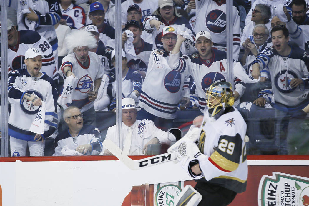 Winnipeg Jets fans taunt Vegas Golden Knights goaltender Marc-Andre Fleury (29) during the second period of Game 1 of the NHL hockey playoffs Western Conference final, Saturday, May 12, 2108, in W ...