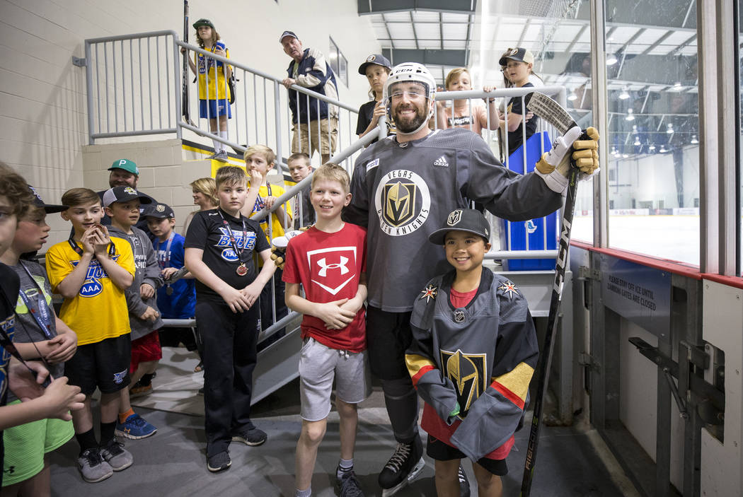 Vegas Golden Knights defenseman Brad Hunt, center, poses with nine-year-olds Ryden Duchon, left, and Tyler Cordoviz after taking part in an optional team practice at the Bell MTS Iceplex in Winnip ...