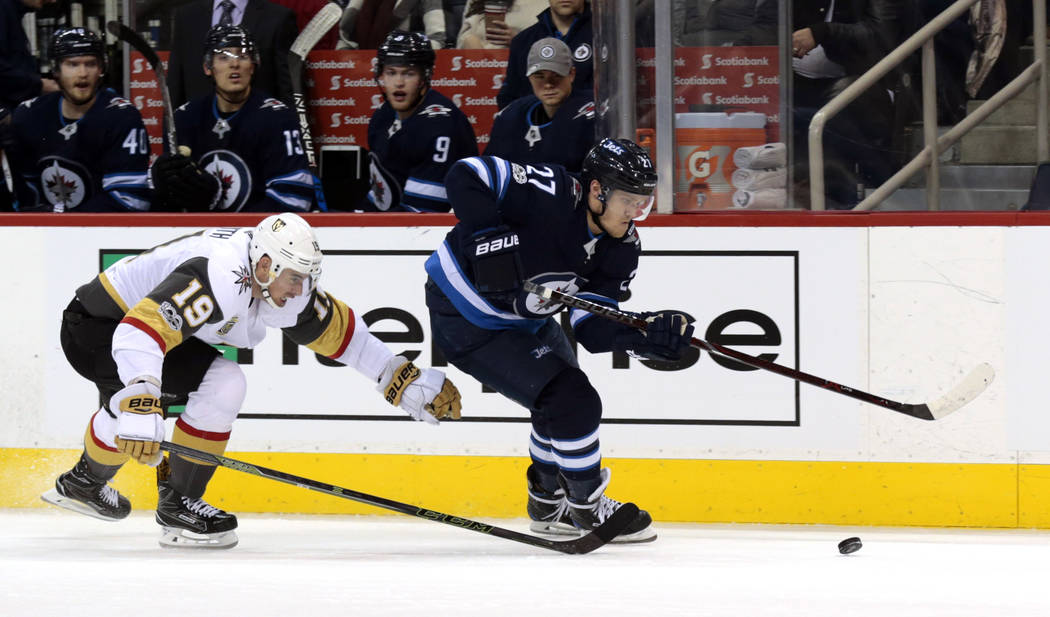 Dec 1, 2017; Winnipeg, Manitoba, CAN; Vegas Golden Knights right wing Reilly Smith (19) chases down Winnipeg Jets left wing Nikolaj Ehlers (27) in second period play at Bell MTS Place. (James Car ...