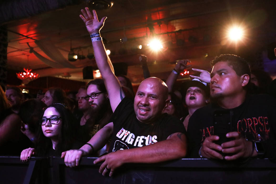 Oscar Munoz, of Los Angeles, watches Devourment perform at the Las Vegas Death Fest at Fremont Country Club in Las Vegas on Saturday, May 12, 2018. The death metal festival featured 48 acts over t ...