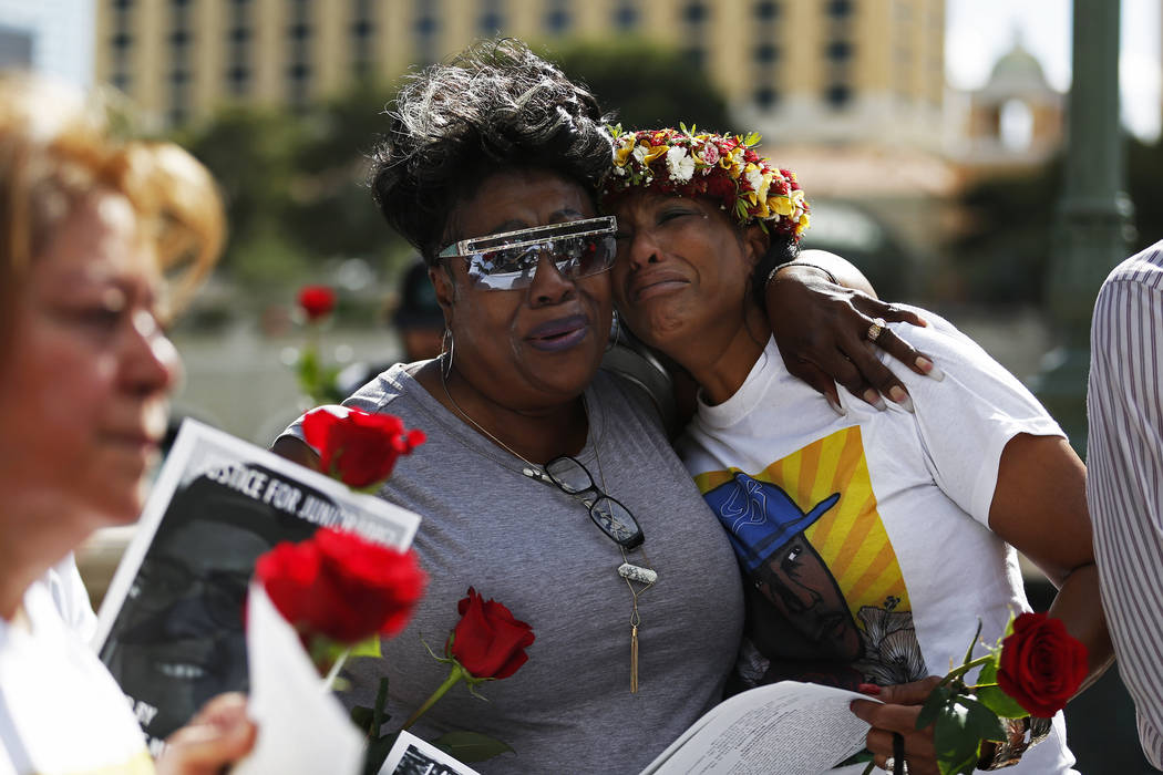 Margie Day embraces Trinita Farmer, whose son Tashii Brown died in the custody of the Metropolitan Police Department a year ago, during a vigil for him in front of the Bellagio in Las Vega ...