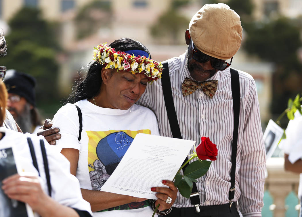 Trinita Farmer, whose son Tashii Brown died in the custody of the Metropolitan Police Department a year ago, is embraced by Cornell McCrary during a vigil in front of the Bellagio in Las V ...