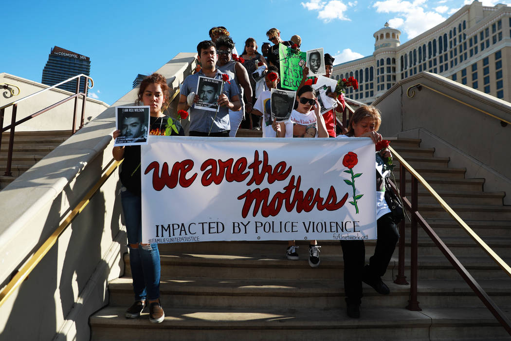 Attendees march towards The Venetian during a vigil for Tashii Brown,whodiedinthecustodyoftheMetropolitanPoliceDepartmentayear&#xa ...