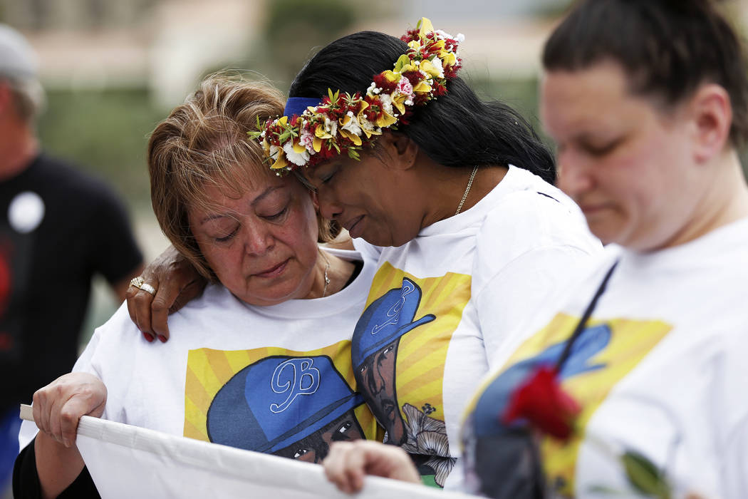 Trinita Farmer, whose son Ta­shii Brown died in th­e custody of the Metr­opolitan Police Depar­tment a year ago, embraces Alma Chavez, during a vigil in front of the Bellagio in Las Vegas on S ...
