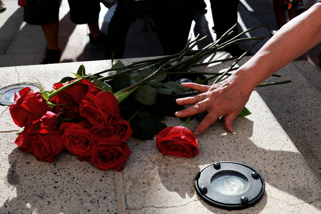 Alma Chavez places a rose near the steps of The Venetian during a vigil for Tashii Brown in Las Vegas on Sunday, May 13, 2018. Andrea Cornejo Las Vegas Review-Journal @dreacornejo