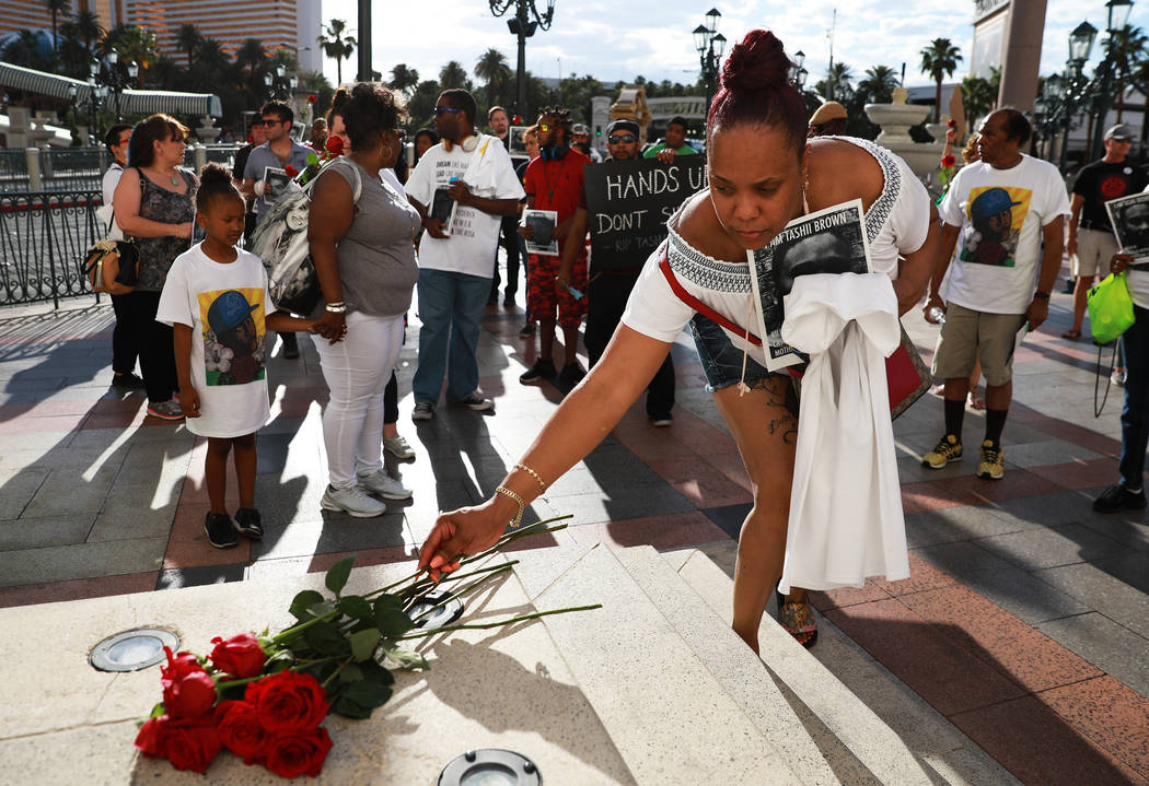 Attendees leave roses for Tashii Brown,who died in the custody of the Metropolitan Police Department a year ago, in front of The Venetian in Las Vegas on Sunday, May 13, 2018.  Andre ...