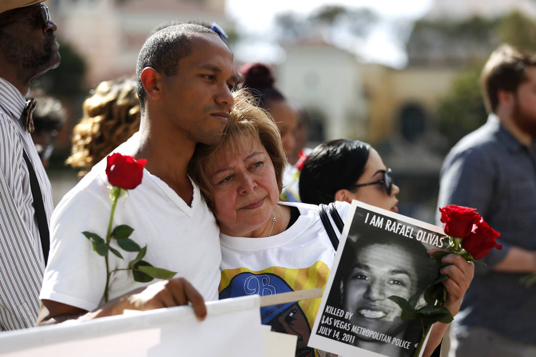 Alma Chavez is embraced by Fern, who wished to only be identified by his last name, during a vigil for Tashii Brown in front of the Bellagio in Las Vegas on Sunday, May 13, 2018.Andrea ...