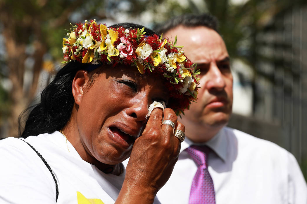 Trinita Farmer, whose son Ta­shii Brown died in th­e custody of the Metr­opolitan Police Depar­tment a year ago, wip­es away tears during a vigil for her son in front of the Bellagio in Las V ...