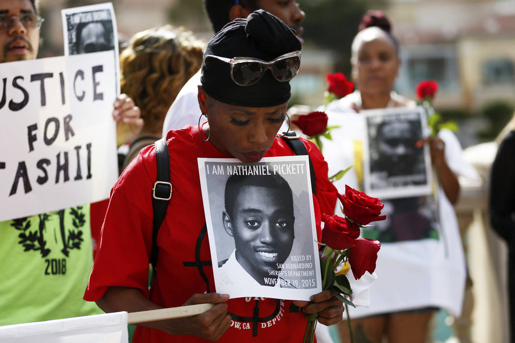 Dominic Archibald attends a vigil for Tashii Brown, who died in the custody of the Metropolitan PoliceDepartment a year ago, in front of the Bellagio in Las Vegas on Sunday, May 13, 2018. Andrea C ...