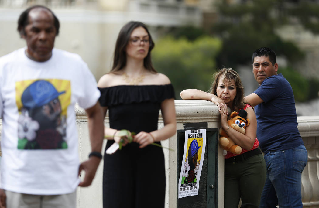 Onlookers stand by a vigil for Tashii Brown, who died in the custody of the Metropolitan Police Department a year ago, at the Bellagio in Las Vegas on Sunday, May 13, 2018. Andrea Cornejo Las Vega ...