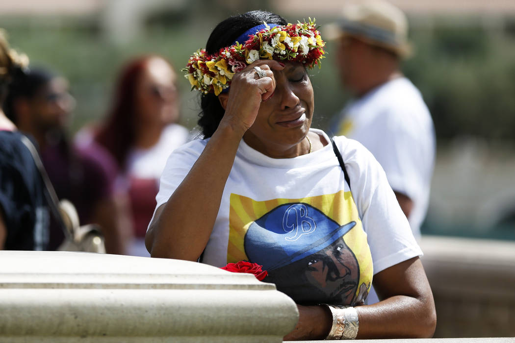 Trinita Farmer, whose son Tashii Brown died in the custody of the Metropolitan Police Department a year ago, wipes away tears during a vigil for her son in front of the Bellagio in Las Veg ...
