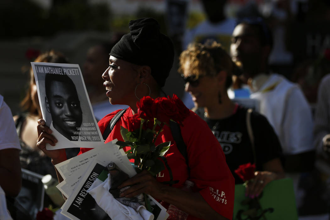 Dominic Archibald attends a vigil for Tashii Brown, who died in the custody of the Metropolitan Police Department a year ago, in front of the Bellagio in Las Vegas on Sunday, May 13, 2018. Andrea ...
