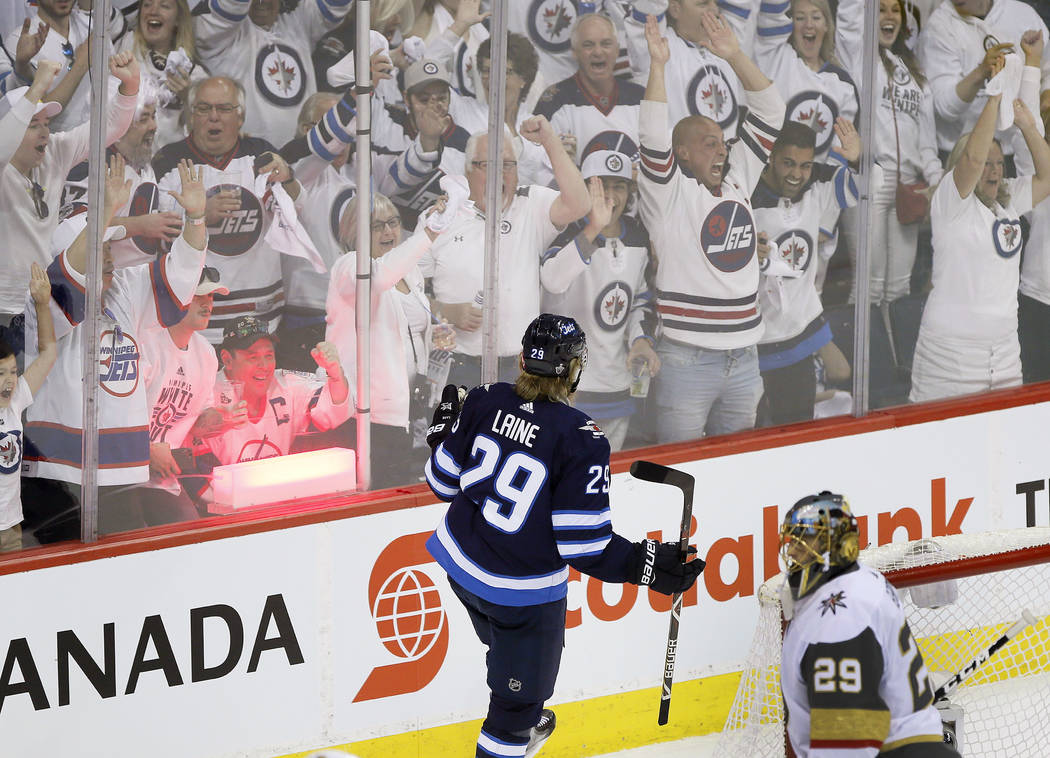 Winnipeg Jets' Patrik Laine (29) celebrates his goal on Vegas Golden Knights goaltender Marc-Andre Fleury (29) during the first period of Game 1 of the NHL hockey playoffs Western Conference final ...