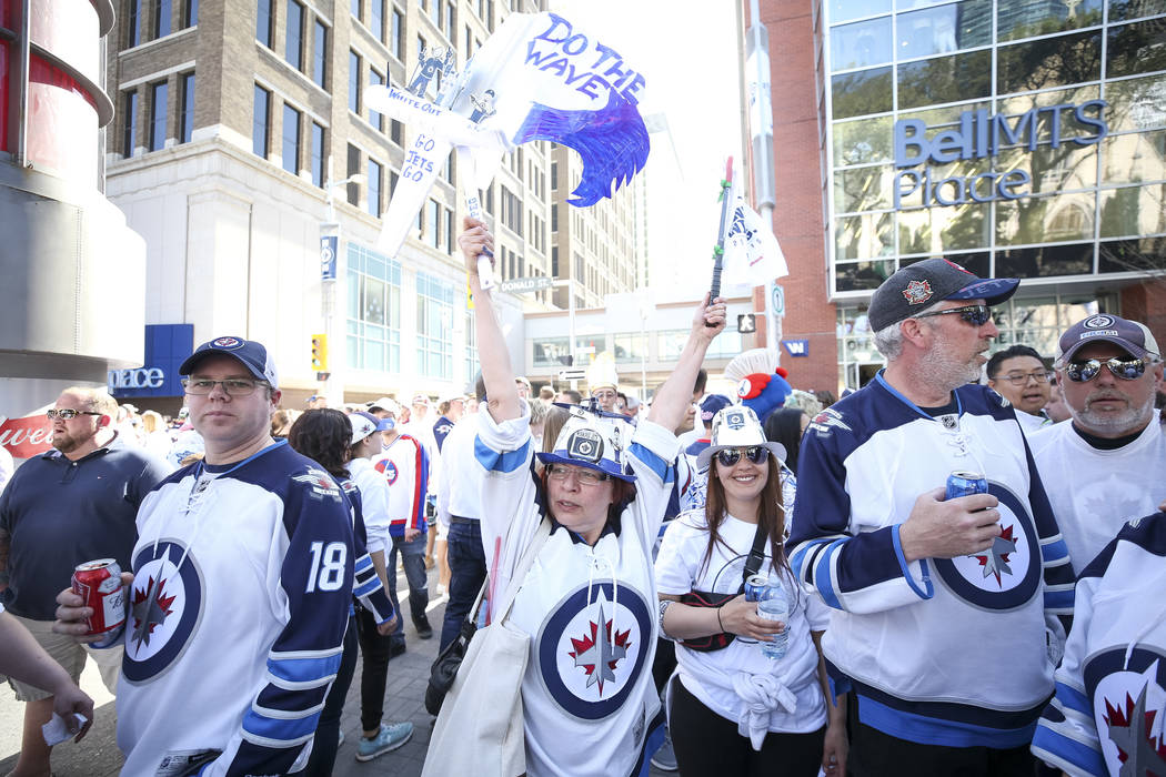 Jet fans gather for a block party ahead of Game 1 between the Vegas Golden Knights and the Winnipeg Jets outside the Bell MTS Place in Winnipeg, Canada, on Saturday, May 12, 2018. Richard Brian La ...