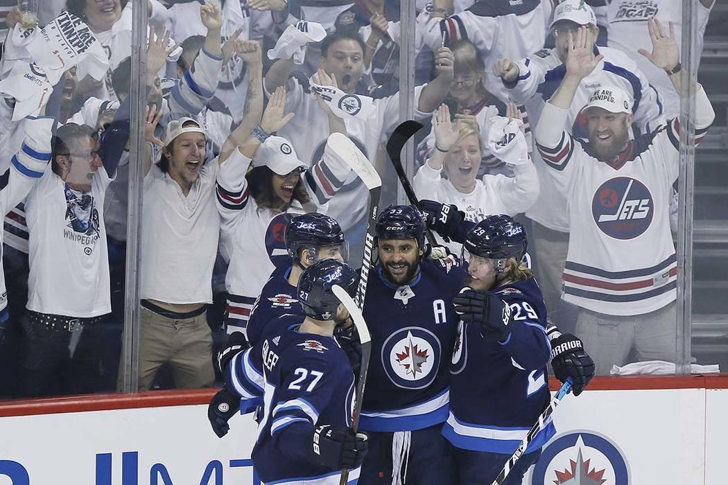 Winnipeg Jets' Nikolaj Ehlers (27), Mark Scheifele (55), Dustin Byfuglien (33) and Patrik Laine (29) celebrate Byfuglien's goal against the Vegas Golden Knights during the first period of Game 1 o ...