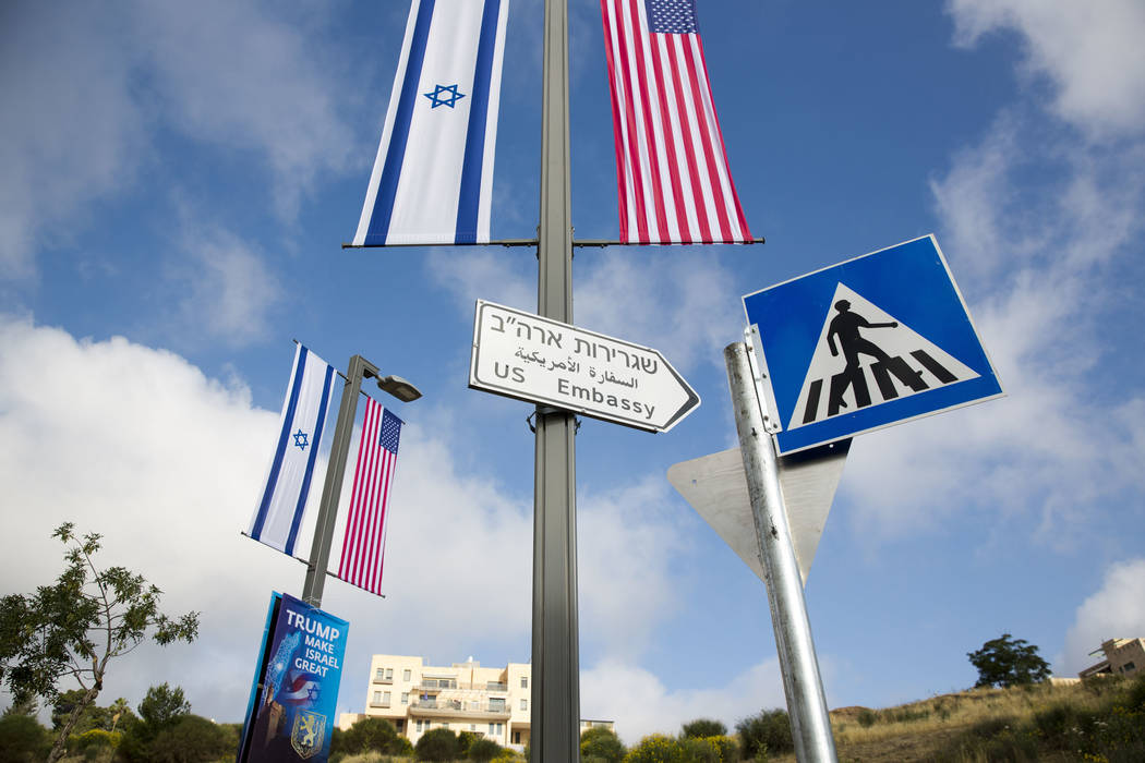A road sign leading to the U.S. Embassy is seen ahead the official opening in Jerusalem, Sunday, May 13, 2018. Monday's opening of the U.S. Embassy in contested Jerusalem, cheered by Israelis as a ...
