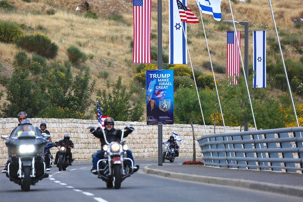 Riders from the Samson Riders, an Israeli motorcycle club, arrive on a road leading to the new U.S. Embassy during a group ride from the old embassy in Tel Aviv, ahead of the official opening, in ...