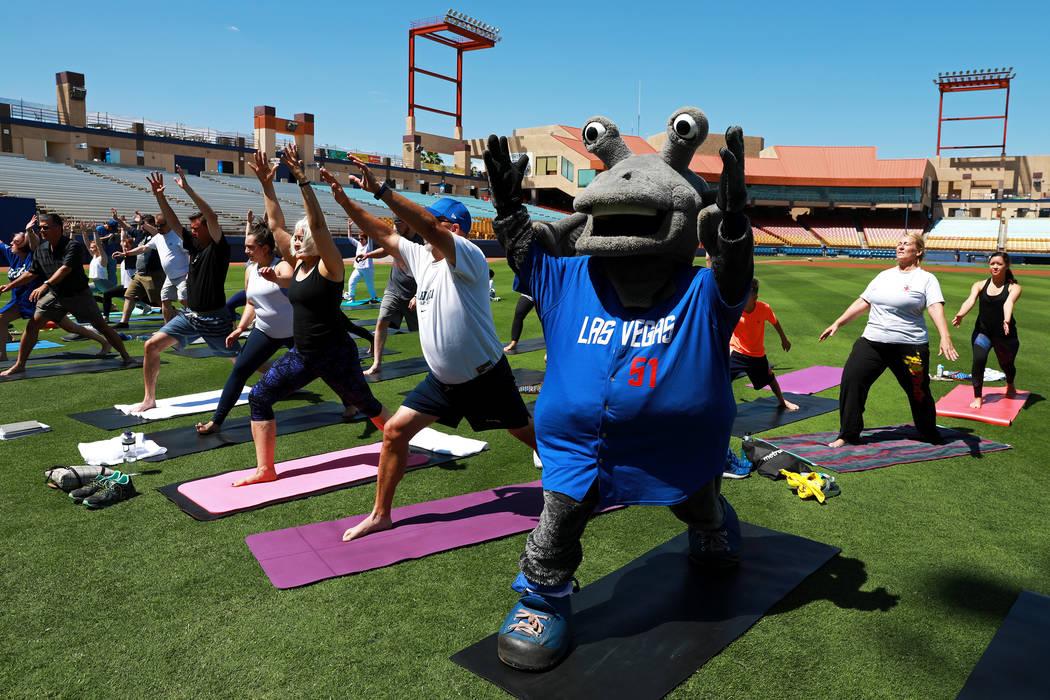 Cosmo, the Las Vegas 51s' mascot, participates in a Yoga on the Field event at Cashman Field in Las Vegas on Sunday, May 13, 2018. Andrea Cornejo Las Vegas Review-Journal @dreacornejo