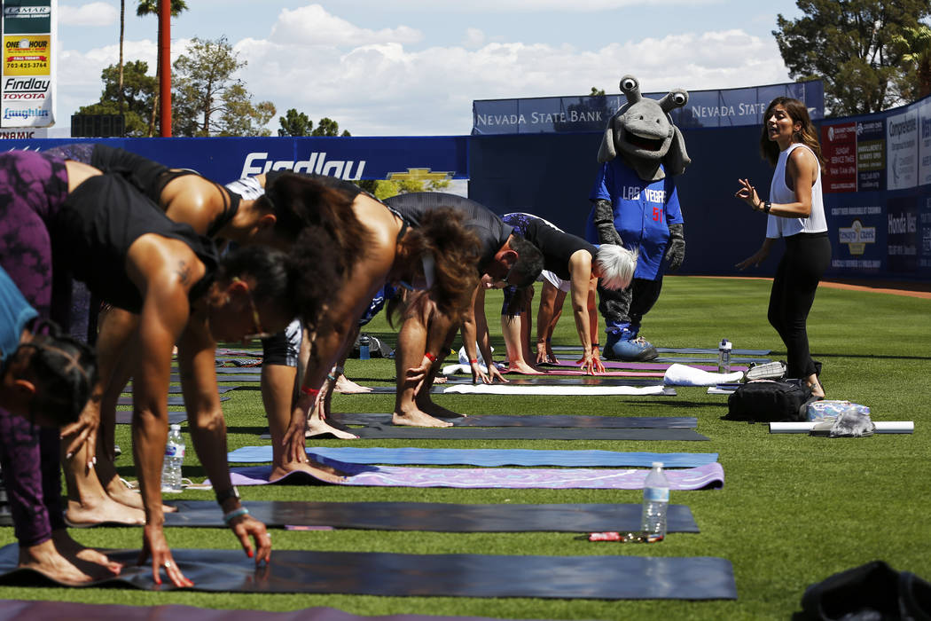 Cosmo, the Las Vegas 51s' mascot, watches yoga instructor Steph Armijo, of New York, during a Yoga on the Field event at Cashman Field in Las Vegas on Sunday, May 13, 2018. Andrea Cornejo Las Vega ...