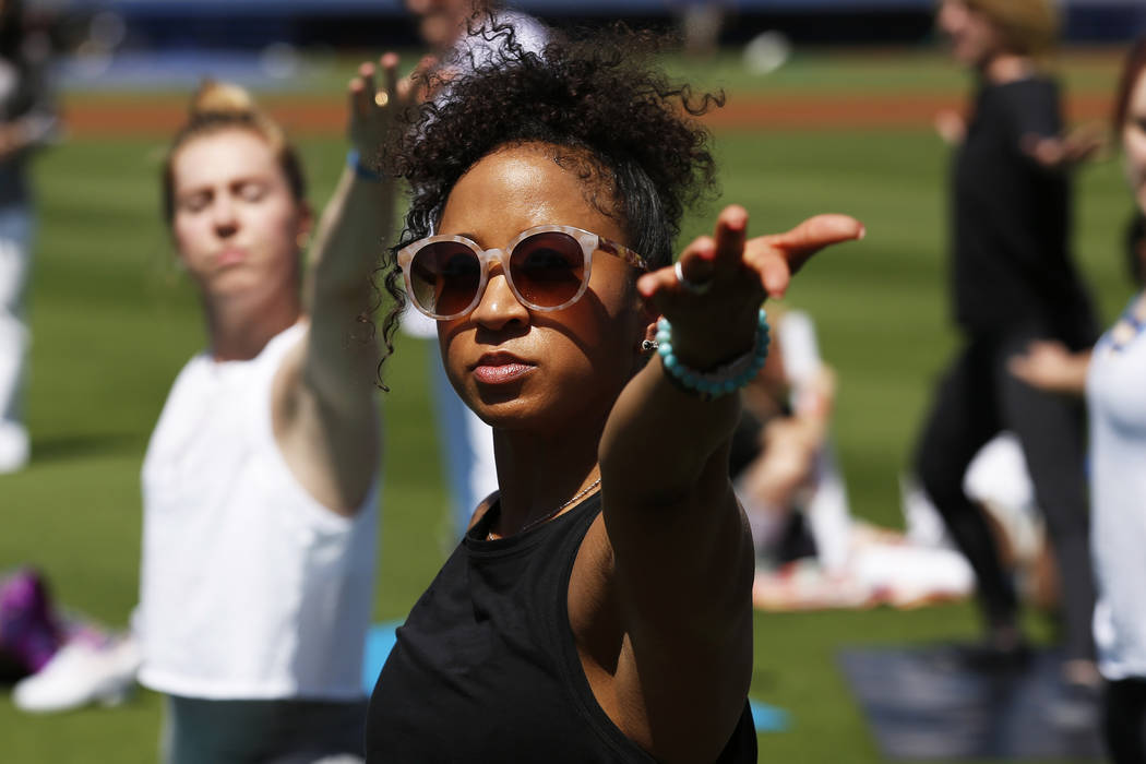 Shaila Bledsoe, of Las Vegas, participates in a Yoga on the Field event at Cashman Field in Las Vegas on Sunday, May 13, 2018. Andrea Cornejo Las Vegas Review-Journal @dreacornejo