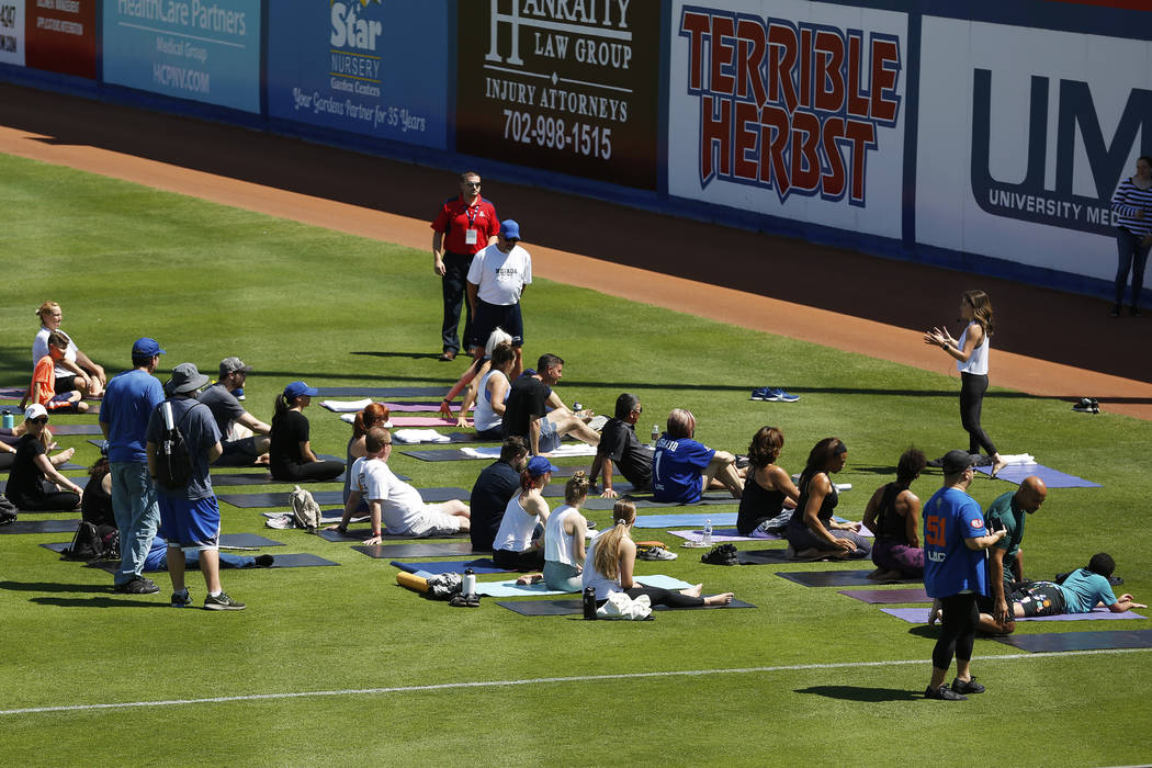 Steph Armijo, of New York, instructs a class during a Yoga on the Field event at Cashman Field in Las Vegas on Sunday, May 13, 2018. Andrea Cornejo Las Vegas Review-Journal @dreacornejo