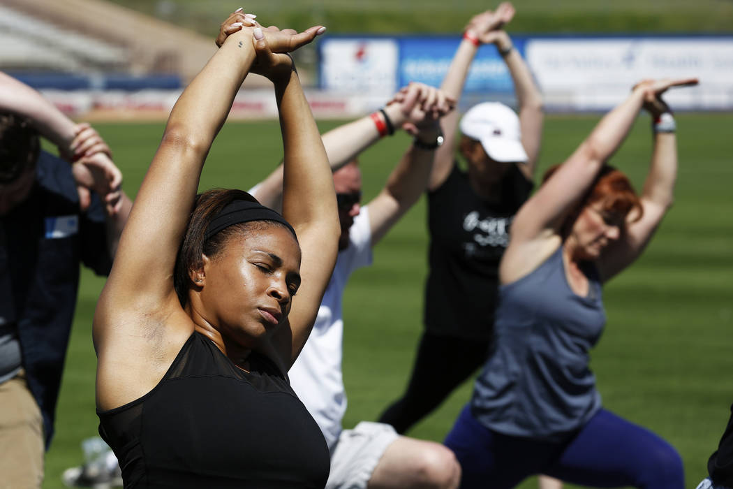 Alicia Wadington, of Las Vegas, participates in a Yoga on the Field event at Cashman Field in Las Vegas on Sunday, May 13, 2018. Andrea Cornejo Las Vegas Review-Journal @dreacornejo