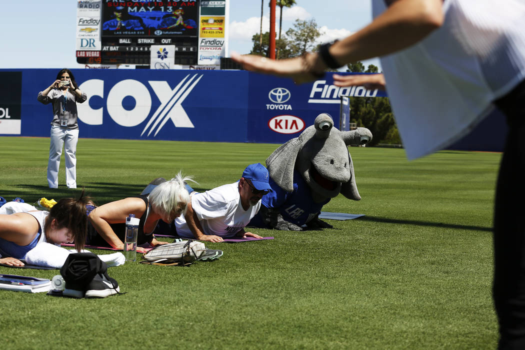 Cosmo, the Las Vegas 51s' mascot, participates in a Yoga on the Field event at Cashman Field in Las Vegas on Sunday, May 13, 2018. Andrea Cornejo Las Vegas Review-Journal @dreacornejo