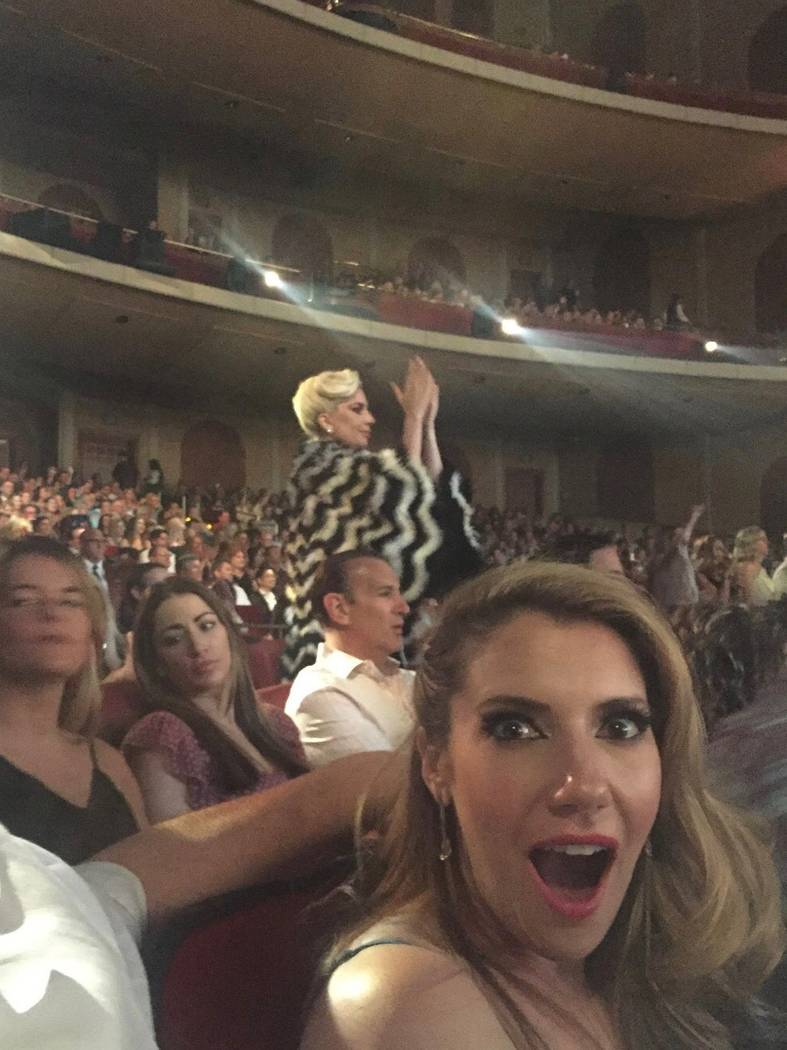 Maren Wade is shown at Elton John's show at the Colosseum at Caesars Palace with Lady Gaga applauding in the background on Saturday, May 12, 2018. (Maren Wade)