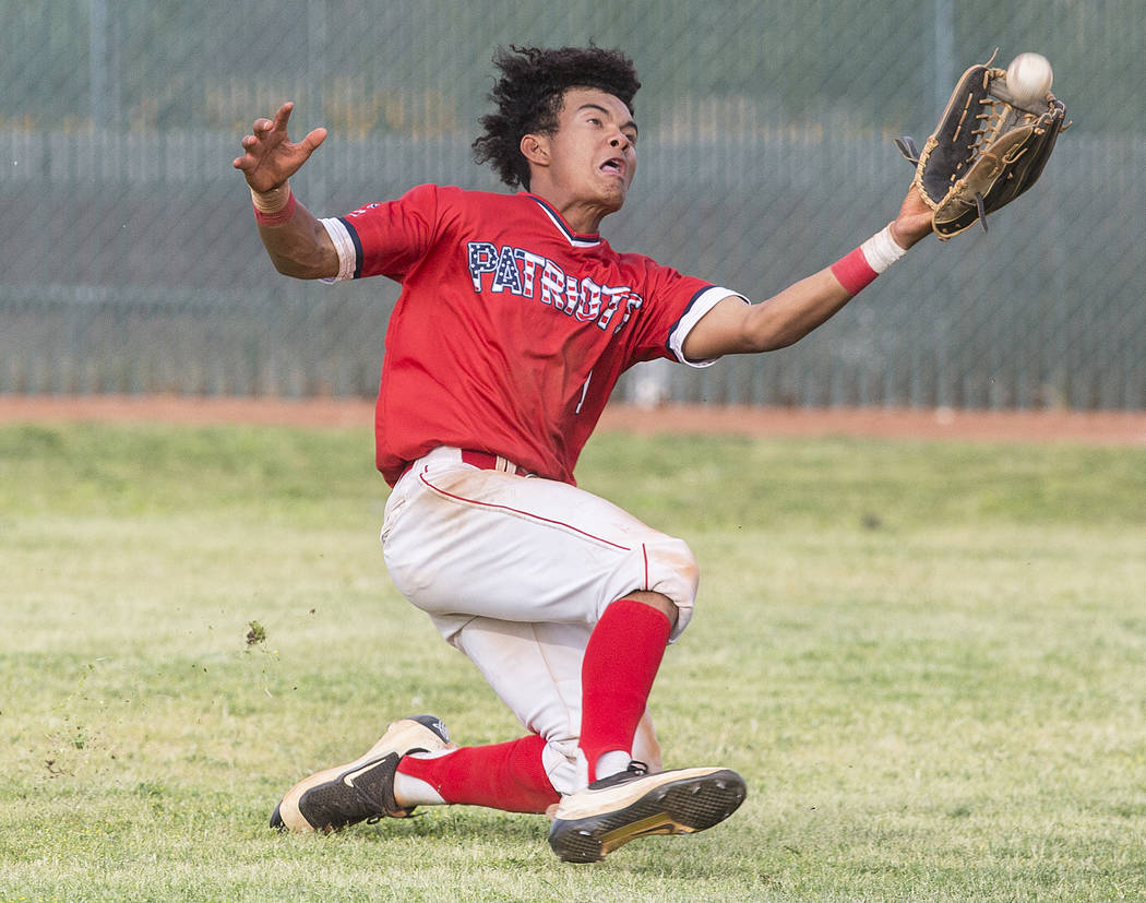 Liberty right fielder Mason Bowden (1) makes a diving catch in the sixth inning during the Patriots home matchup with Coronado High School during the opening round of the Sunrise Region baseball t ...