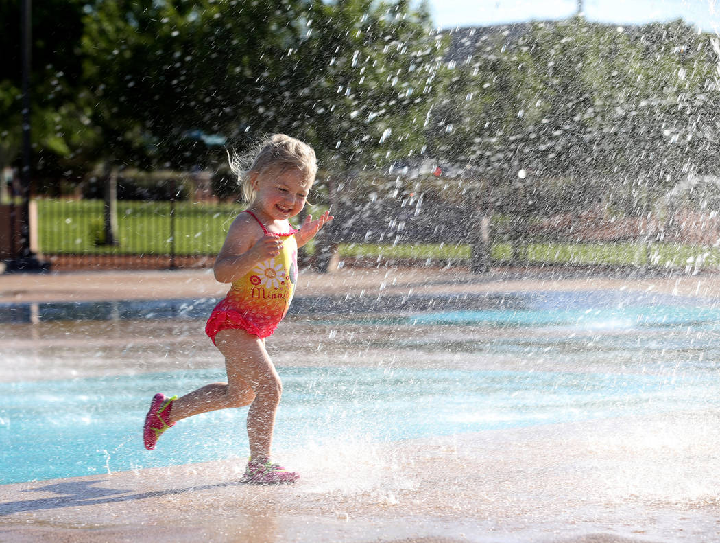 Summer Rae Smith, 3, of Henderson plays on the splash pad at Paseo Vista Park in Henderson Monday, May 7, 2018. K.M. Cannon Las Vegas Review-Journal @KMCannonPhoto