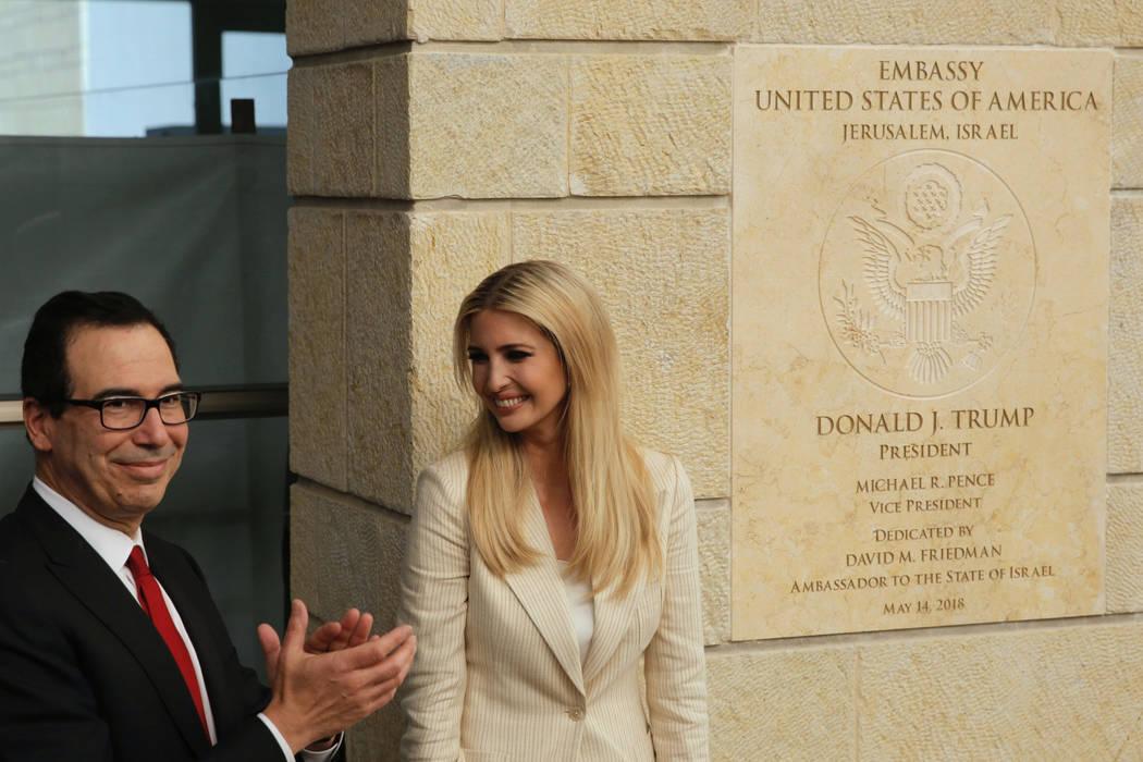 U.S. President Donald Trump's daughter Ivanka Trump, right, and U.S. Treasury Secretary Steve Mnuchin attend the opening ceremony of the new U.S. embassy in Jerusalem, Monday, May 14, 2018. Amid d ...