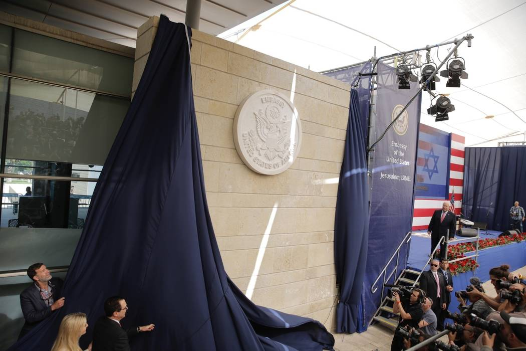 U.S. President Donald Trump's daughter Ivanka Trump, left, and U.S. Treasury Secretary Steve Mnuchin unveil an inauguration plaque during the opening ceremony of the new US embassy in Jerusalem, M ...
