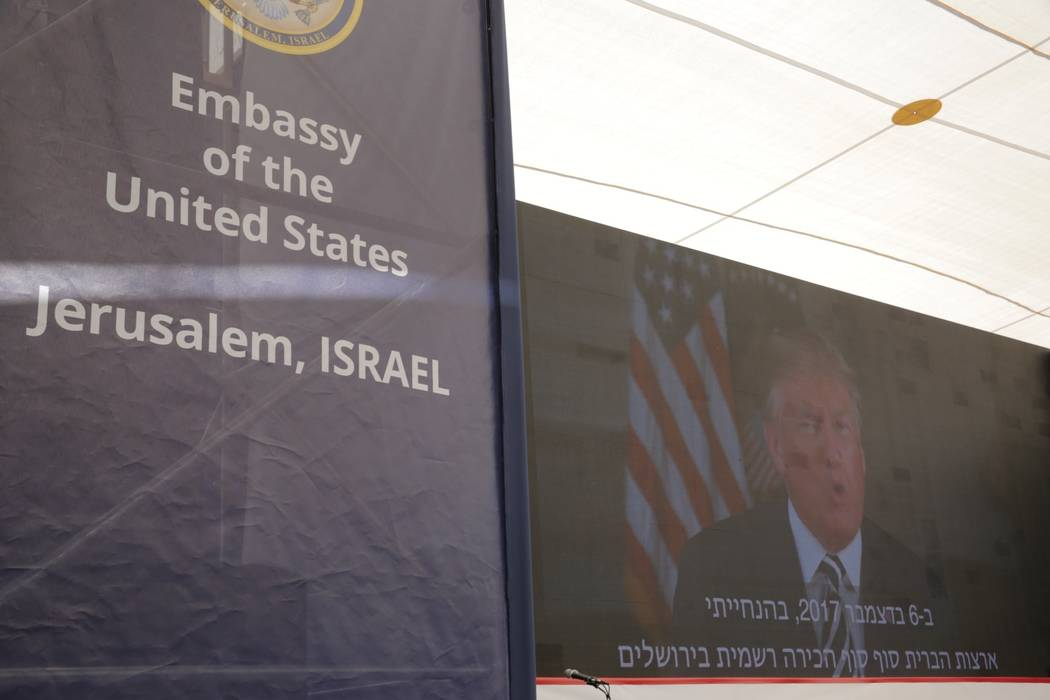U.S. President Donald Trump is seen on screen as he delivers his speech during the opening ceremony of the new U.S. embassy in Jerusalem, Monday, May 14, 2018. Amid deadly clashes along the Israel ...